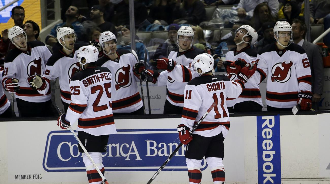 New Jersey Devils' Devante Smith-Pelly (25) celebrates his goal with teammates during the second period of an NHL hockey game against the San Jose Sharks on Thursday, March 10, 2016, in San Jose, Calif. (AP Photo/Marcio Jose Sanchez)