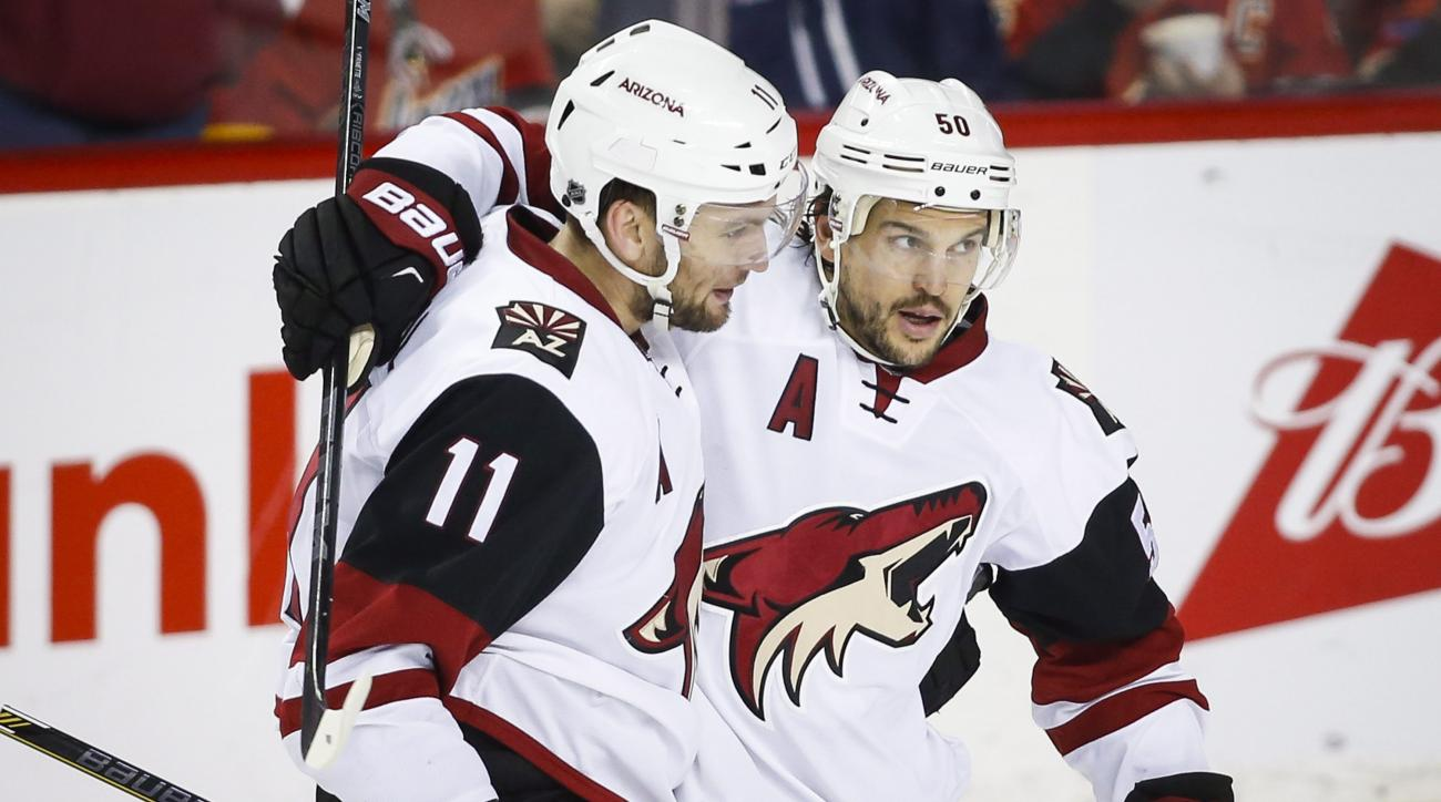 Arizona Coyotes' Antoine Vermette, right, celebrates his goal with Martin Hanzal, of Czech Republic, during the third period of an NHL hockey game against the Calgary Flames, Friday, March 11, 2016, in Calgary, Alberta. (Jeff McIntosh/The Canadian Press v