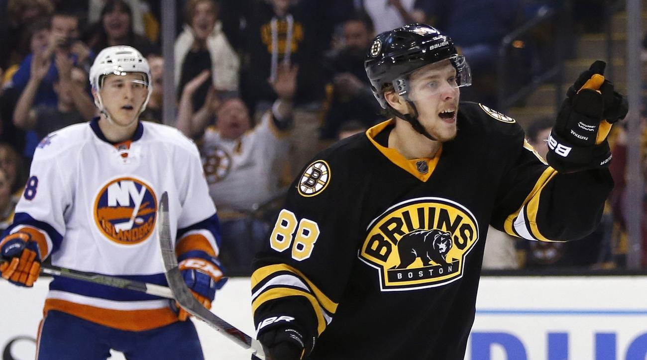 Boston Bruins' David Pastrnak (88) celebrates his goal in front of New York Islanders' Ryan Strome (18) during the second period of an NHL hockey game in Boston, Saturday, March 12, 2016. The Bruins won 3-1. (AP Photo/Michael Dwyer)