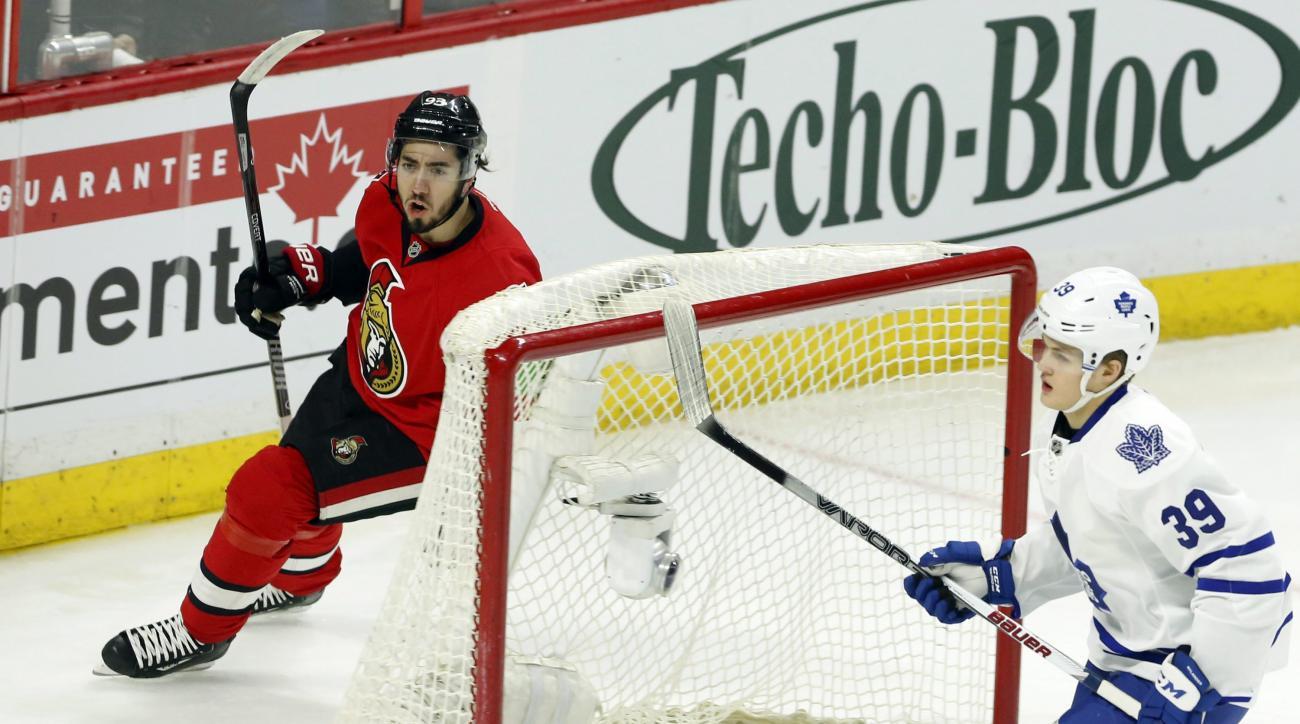 Ottawa Senators' Mika Zibanejad (93) celebrates his goal as Toronto Maple Leafs' William Nylander (39) looks on during the first period of an NHL hockey gane in Ottawa, Ontario, Saturday, March 12, 2016. (Fred Chartrand/The Canadian Press via AP) MANDATOR