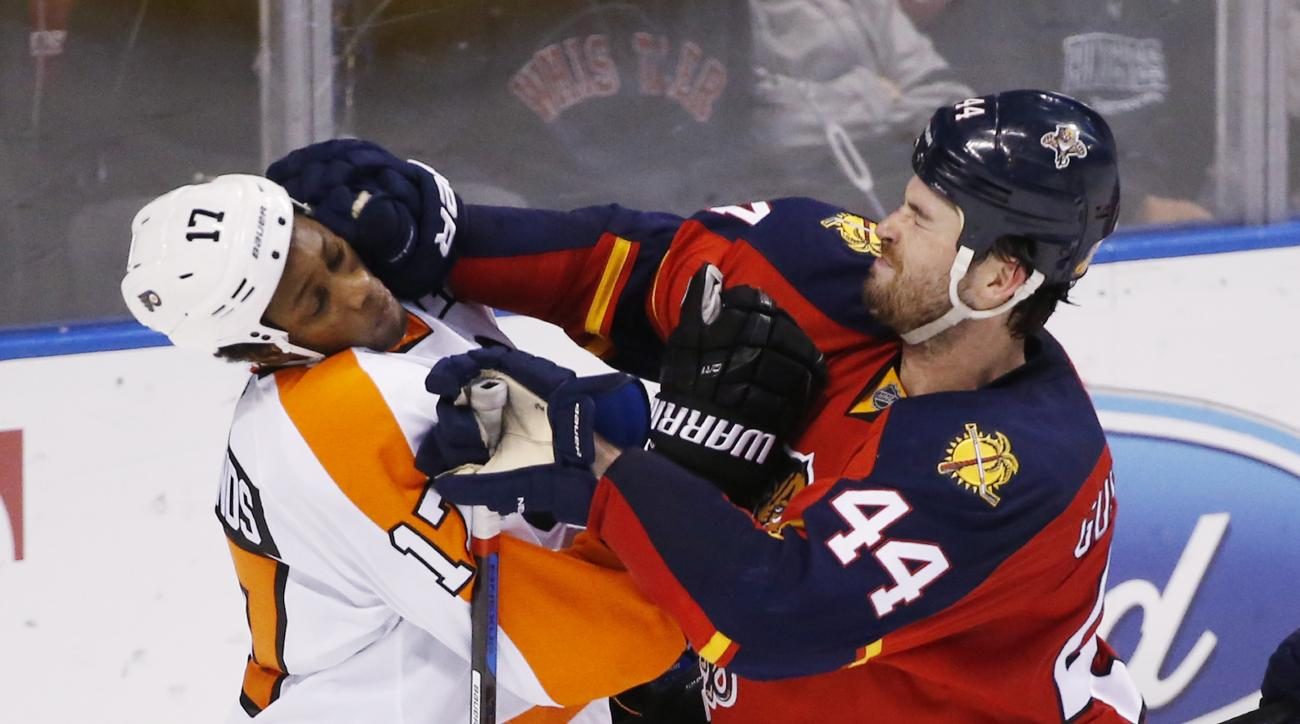Florida Panthers defenseman Erik Gudbranson (44) and Philadelphia Flyers right wing Wayne Simmonds (17) scuffle during an overtime period of an NHL hockey game, Saturday, March 12, 2016, in Sunrise, Fla.  (AP Photo/Wilfredo Lee)