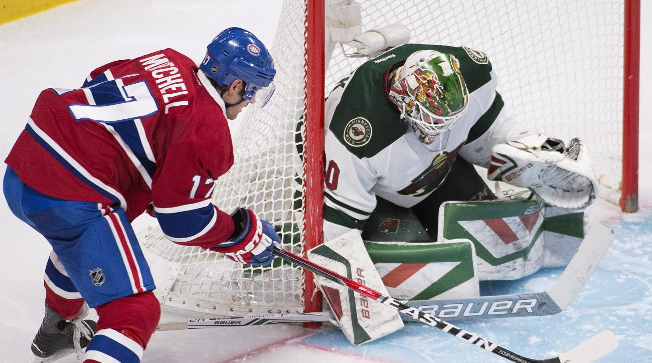 Montreal Canadiens' Torrey Mitchell moves in on Minnesota Wild's goalie Devan Dubnyk during the third period of an NHL hockey game in Montreal on Saturday, March 12, 2016. (Graham Hughes /The Canadian Press via AP) MANDATORY CREDIT