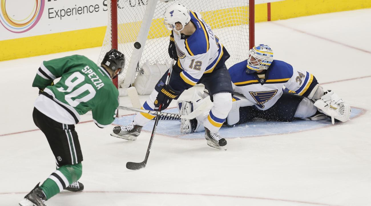 Dallas Stars forward Jason Spezza (90)  scores a goal as St. Louis Blues forward Jori Lehtera (12) and goalie Jake Allen (34) defend during the third period of an NHL hockey game Saturday, March 12, 2016, in Dallas. (AP Photo/Brandon Wade)