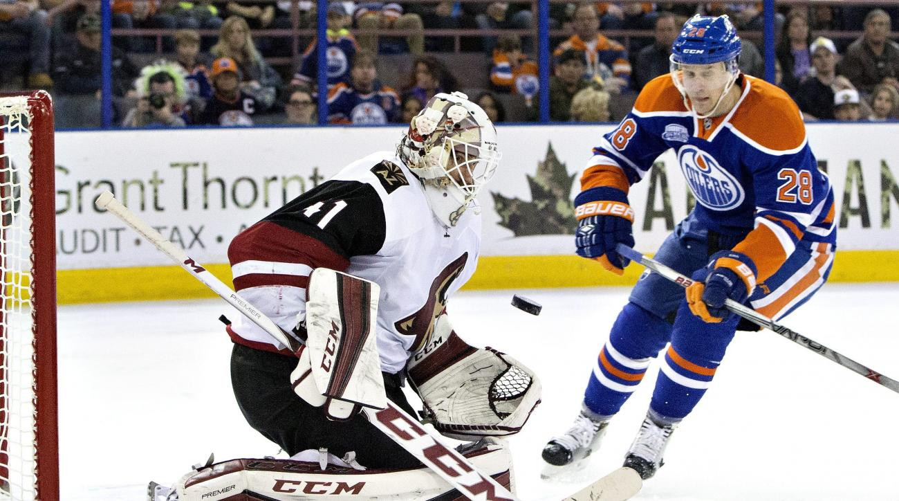 Arizona Coyotes' goalie Mike Smith (41) makes a save on Edmonton Oilers' Leon Draisaitl (29) during the second period of an NHL hockey game in Edmonton, Alberta, Saturday, March 12, 2016. (Jason Franson/The Canadian Press via AP) MANDATORY CREDIT