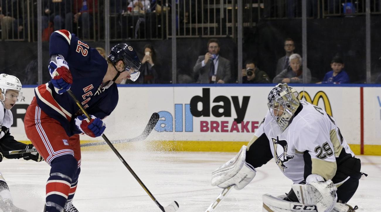 Pittsburgh Penguins goalie Marc-Andre Fleury (29) stops a shot by New York Rangers center Eric Staal (12) in the second period of an NHL hockey game, Sunday, March 13, 2016, in New York. (AP Photo/Adam Hunger)