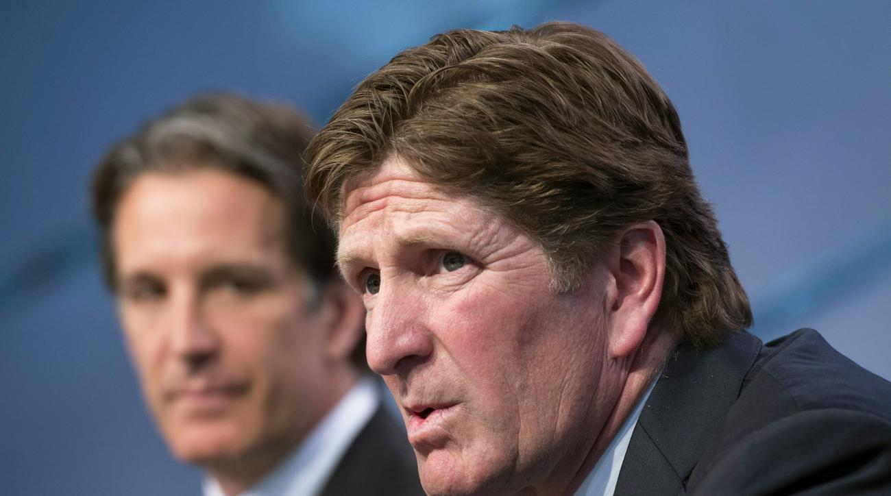 FILE - In this May 21, 2015, file photo, new Toronto Maple Leafs head coach Mike Babcock, right, speaks to reporters with team president Brendan Shanahan during an NHL hockey news conference in Toronto. At their annual March meeting this week, NHL general