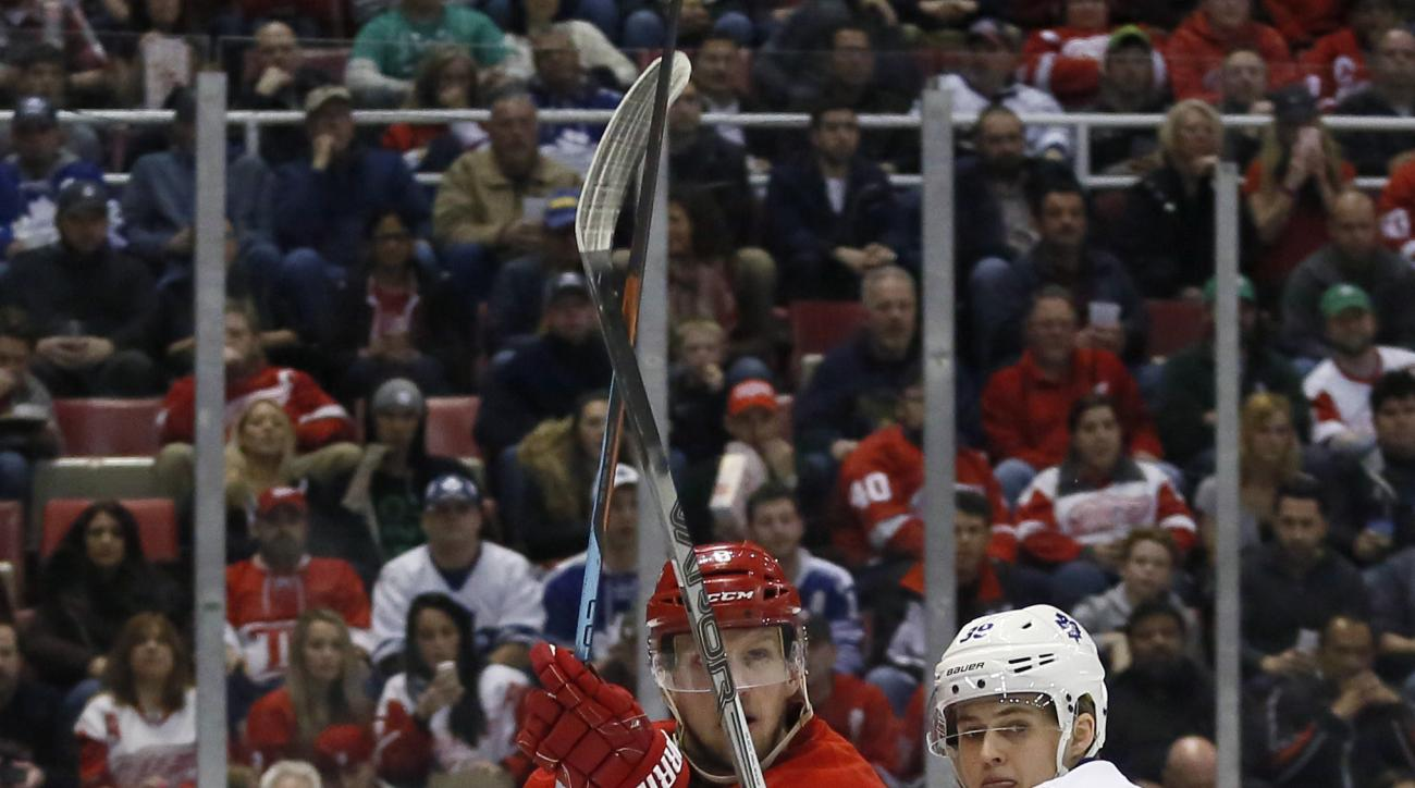 Detroit Red Wings' Justin Abdelkader (8) is guarded by Toronto Maple Leafs' William Nylander (39) during the second period of an NHL hockey game, Sunday, March 13, 2016, in Detroit. (AP Photo/Duane Burleson)
