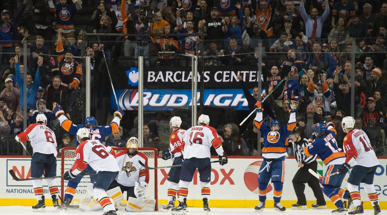 New York Islanders right wing Cal Clutterbuck (15), third from right, celebrates scoring a goal in the third period of an NHL hockey game against the Florida Panthers in New York, Monday, March 14, 2016. The Islanders won 3-2. (AP Photo/Bryan R. Smith)