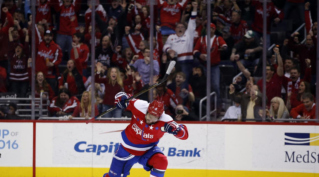 Washington Capitals left wing Alex Ovechkin (8), from Russia, celebrates his game winning goal in the overtime period of an NHL hockey game against the Carolina Hurricanes, Tuesday, March 15, 2016, in Washington. The Capitals won 2-1 in overtime. (AP Phot