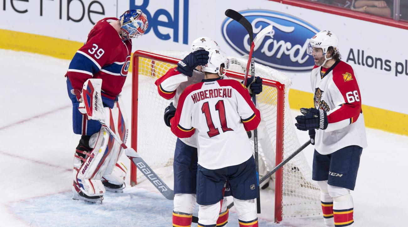 Florida Panthers' Aleksander Barkov, center rear, is congratulated by teammates Jonathan Huberdeau and Jaromir Jagr, right, following a goal against Montreal Canadiens goalie Mike Condon during the third period of an NHL hockey game Tuesday, March 15, 201