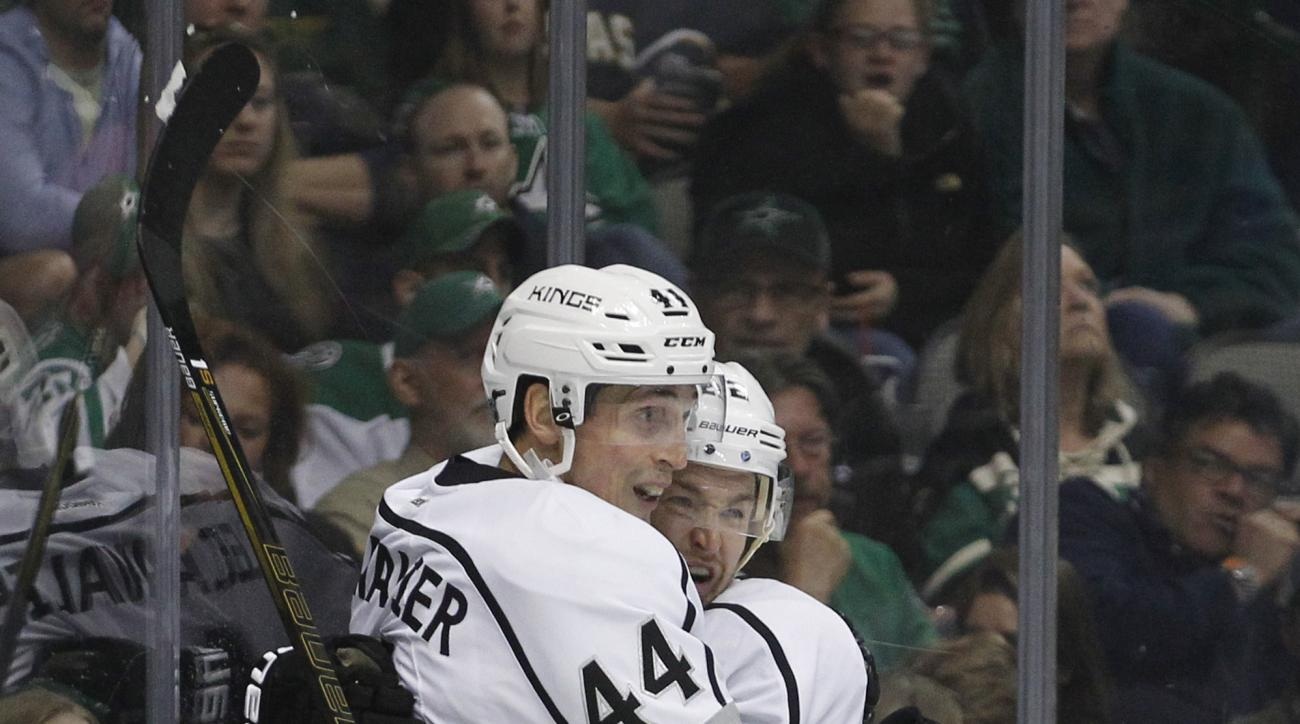Los Angeles Kings center Trevor Lewis celebrates with Los Angeles Kings center Vincent Lecavalier (44) after scoring against Dallas Stars goalie Antti Niemi (not shown) during the second period of an NHL hockey game, Tuesday, March 15, 2016, in Dallas. (A