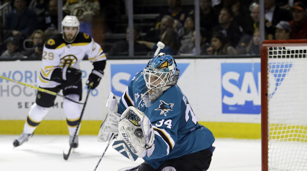 San Jose Sharks goalie James Reimer (34) stops a shot against the Boston Bruins during the second period of an NHL hockey game Tuesday, March 15, 2016, in San Jose, Calif. (AP Photo/Marcio Jose Sanchez)