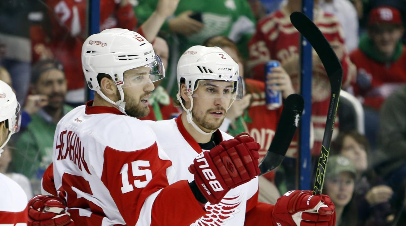 Detroit Red Wings' Riley Sheahan, left, and Brendan Smith celebrate their goal against the Columbus Blue Jackets during the first period of an NHL hockey game Thursday, March 17, 2016, in Columbus, Ohio. (AP Photo/Jay LaPrete)