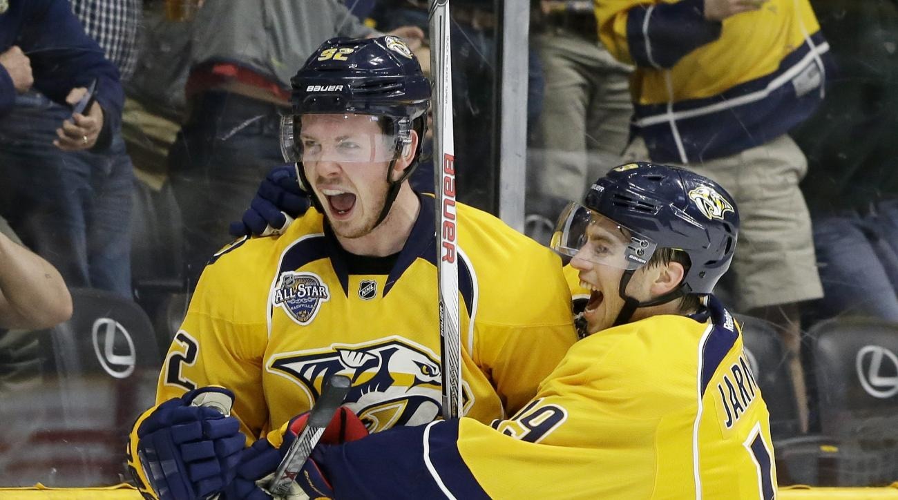 Nashville Predators center Ryan Johansen (92) is congratulated by Calle Jarnkrok (19), of Sweden, after scoring a goal against the New York Islanders in the second period of an NHL hockey game Thursday, March 17, 2016, in Nashville, Tenn. (AP Photo/Mark H