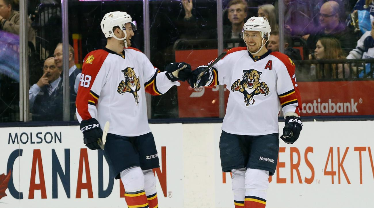 Florida Panthers' Logan Shaw (48) and Jussi Jokinen (36) celebrate a goal by Jokinen during the second period of an NHL hockey game Thursday, March 17, 2016, in Toronto. (Peter Power/The Canadian Press via AP)
