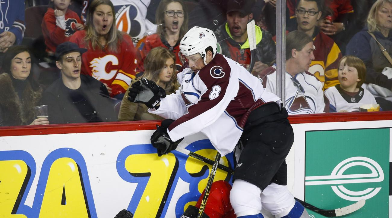 Colorado Avalanche Jack Skille, right, slams Calgary Flames' Jyrki Jokipakka, of Finland, to the ice during the second period of an NHL hockey game, Friday, March 18, 2016 in Calgary, Alberta. (Jeff McIntosh/The Canadian Press via AP) MANDATORY CREDIT