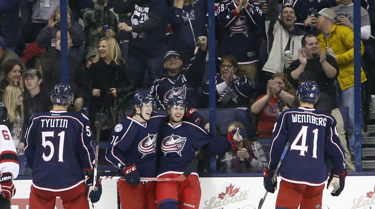 Columbus Blue Jackets' Oliver Bjorkstrand, right, of Denmark, celebrates his goal with teammate Matt Calvert against the New Jersey Devils during the third period of an NHL hockey game, Saturday, March 19, 2016, in Columbus, Ohio. The Blue Jackets beat th
