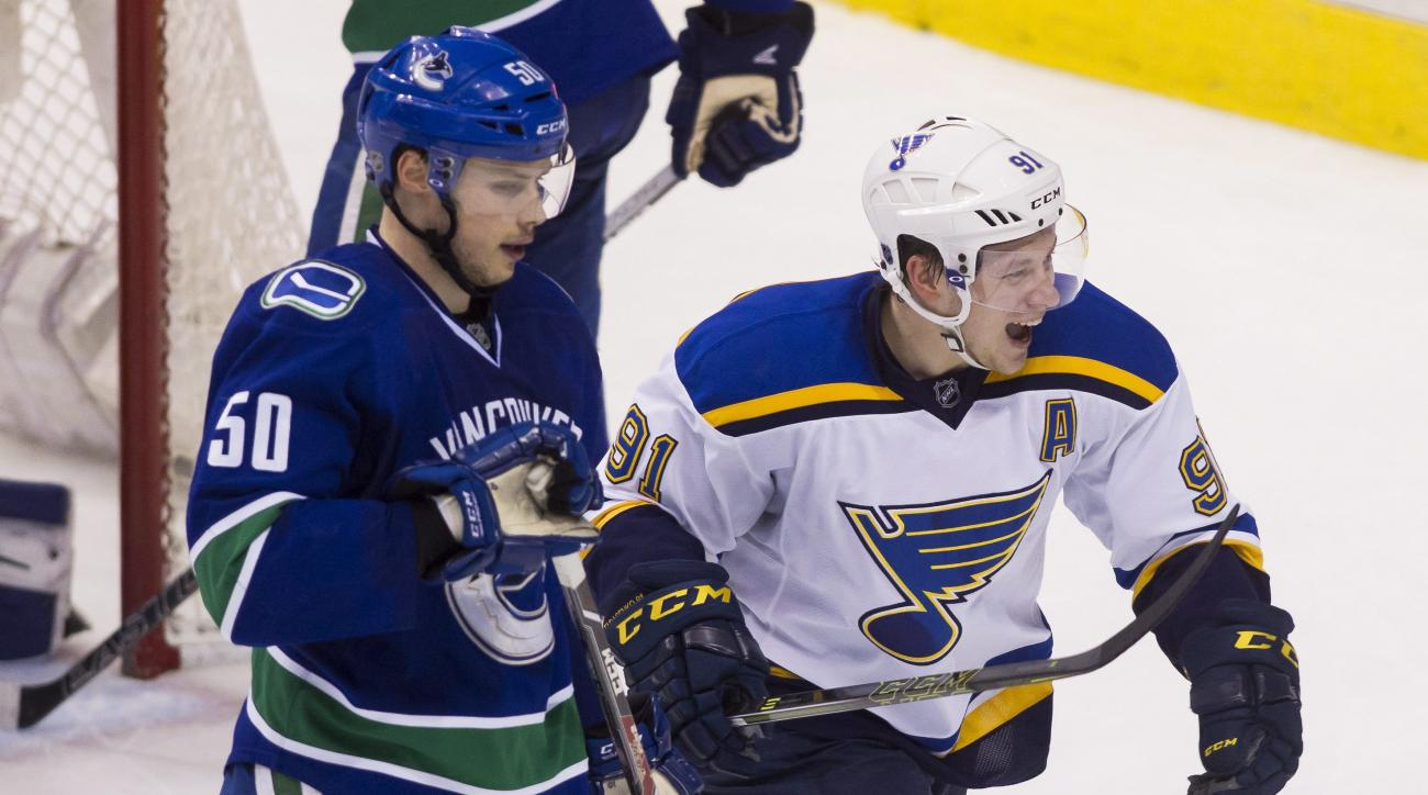 St. Louis Blues' Vladimir Tarasenko (91) celebrates his goal against the Vancouver Canucks as he skates past Canucks' Brendan Gaunce (50) during the third period of an NHL hockey game Saturday, March 19, 2016, in Vancouver, British Columbia. (Ben Nelms/Th
