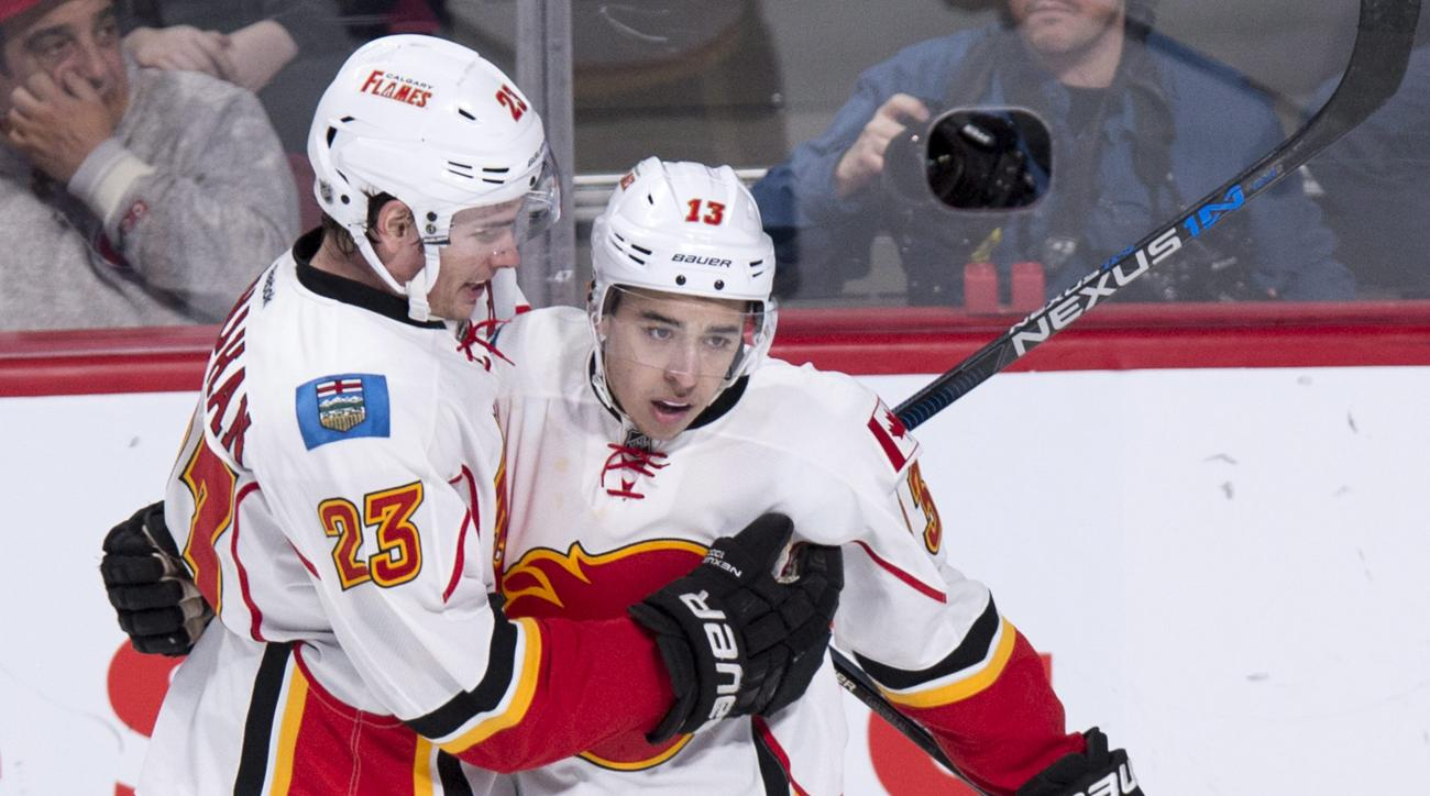 Calgary Flames' Johnny Gaudreau, right, celebrates his goal against the Montreal Canadiens with teammate Sean Monahan during the third period of an NHL hockey game Sunday, March 20, 2016, in Montreal. (Paul Chiasson/The Canadian Press via AP) MANDATORY CR