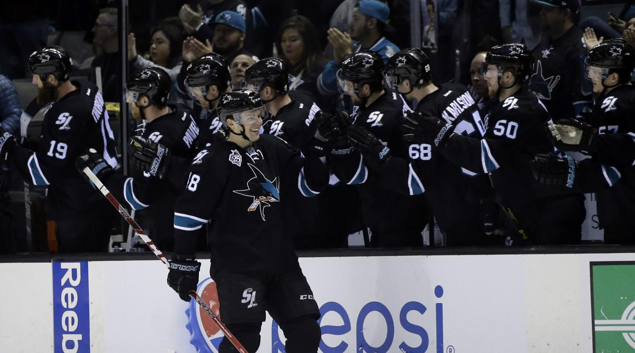 San Jose Sharks' Tomas Hertl (48) celebrates his goal with teammates during the second period of an NHL hockey game against the Arizona Coyotes Sunday, March 20, 2016, in San Jose, Calif. (AP Photo/Marcio Jose Sanchez)