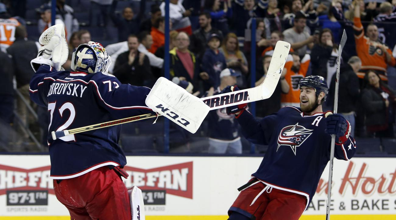 Columbus Blue Jackets' Sergei Bobrovsky, left, of Russia, and Brandon Dubinsky celebrate the team's 3-2 win in a shootout over the Philadelphia Flyers in an NHL hockey game Tuesday, March 22, 2016, in Columbus, Ohio. (AP Photo/Jay LaPrete)