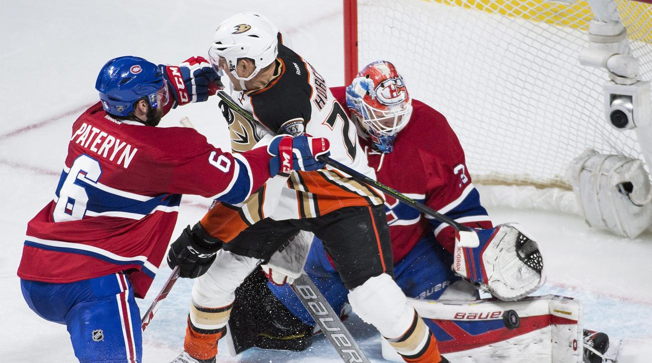 Montreal Canadiens' goalie Mike Condon makes a save against Anaheim Ducks' Shawn Horcoff as Canadiens' Greg Pateryn (6) defends during third period NHL hockey action in Montreal on Tuesday, March 22, 2016. (Graham Hughes/The Canadian Press via AP)