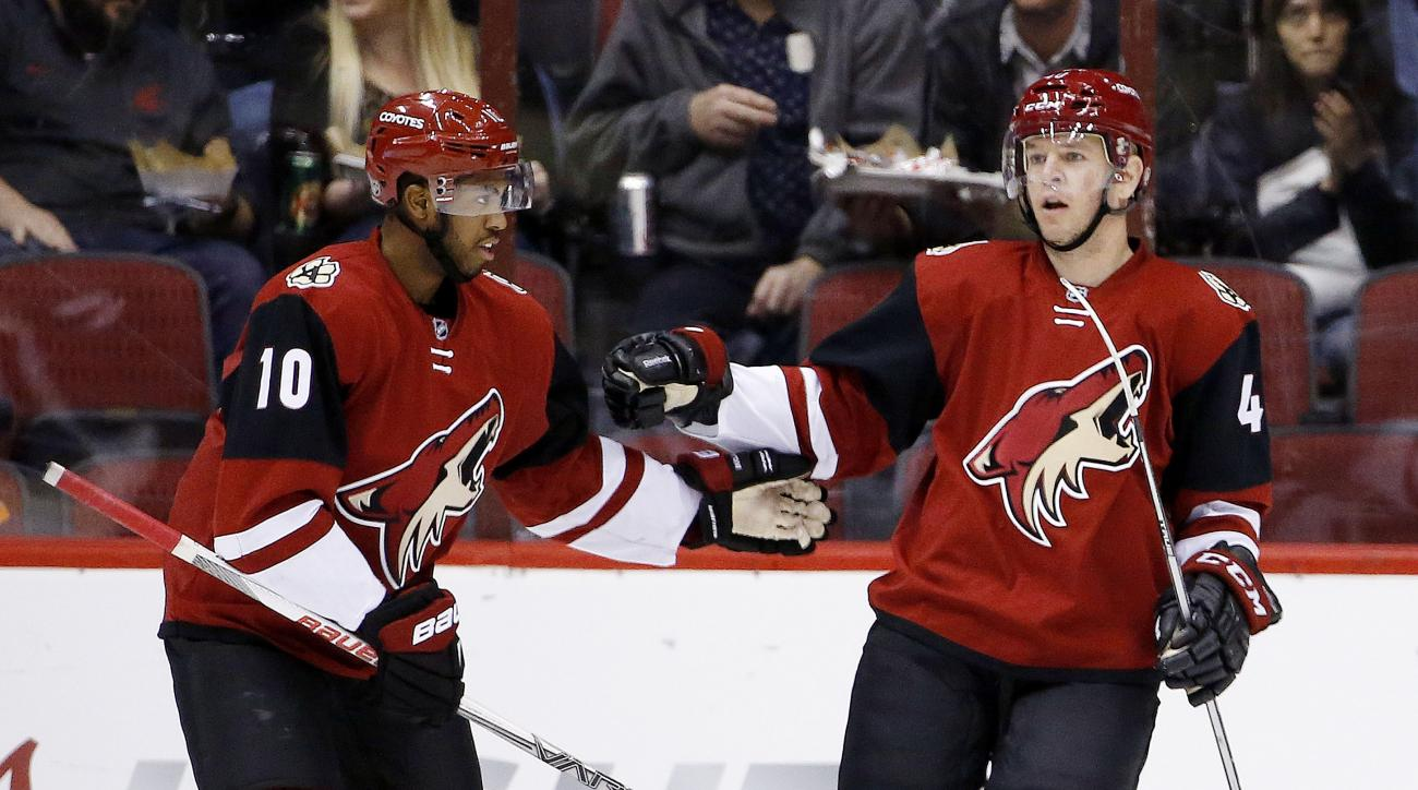 Arizona Coyotes' Alex Tanguay, right, celebrates his goal against the Edmonton Oilers with Anthony Duclair (10) during the first period of an NHL hockey game, Tuesday, March 22, 2016, in Glendale, Ariz. (AP Photo/Ross D. Franklin)