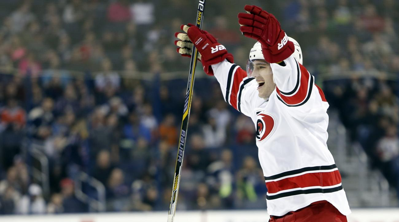 Carolina Hurricanes' Noah Hanifin celebrates a goal against the Columbus Blue Jackets during the third period of an NHL hockey game, Thursday, March 24, 2016, in Columbus, Ohio. The Hurricanes defeated the Blue Jackets 3-2. (AP Photo/Jay LaPrete)