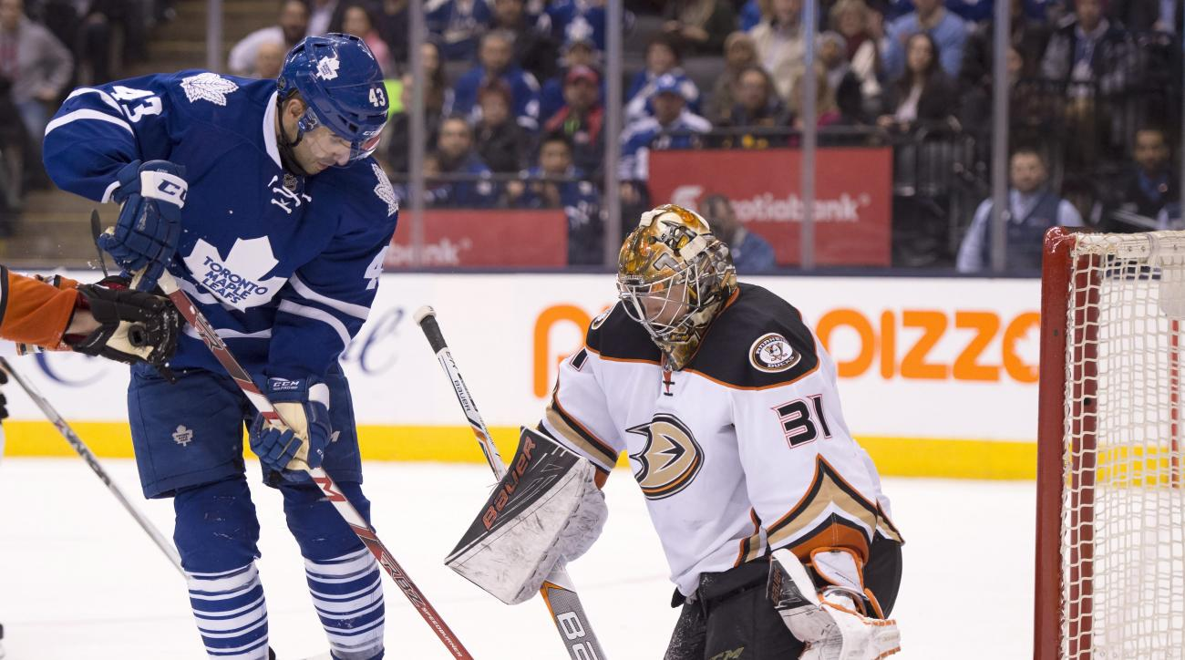 Toronto Maple Leafs centre Nazem Kadri (43) spins in on Anaheim Ducks goaltender Frederik Andersen on his way to scoring the game winning goal during overtime of an NHL hockey game, Thursday, March 24, 2016 in Toronto.  (Frank Gunn/The Canadian Press via