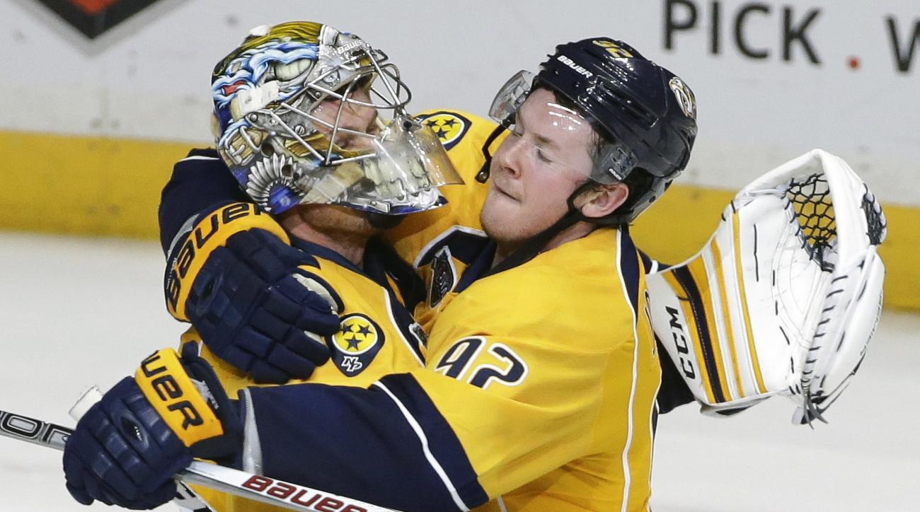 Nashville Predators center Ryan Johansen (92) hugs goalie Pekka Rinne, of Finland, after the Predators beat the Vancouver Canucks in a shootout at an NHL hockey game Thursday, March 24, 2016, in Nashville, Tenn. The Predators won 3-2. (AP Photo/Mark Humph