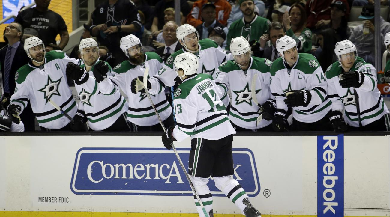 Dallas Stars' Mattias Janmark (13) celebrates with teammates after scoring against the San Jose Sharks during the second period of an NHL hockey game Saturday, March 26, 2016, in San Jose, Calif. (AP Photo/Marcio Jose Sanchez)