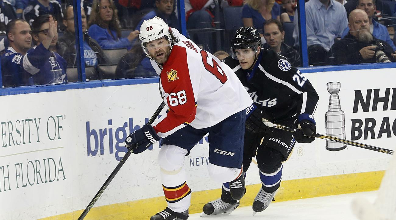 Florida Panthers right wing Jaromir Jagr (68), of the Czech Republic, controls the puck against Tampa Bay Lightning defenseman Matt Carle (25) during the first period of an NHL hockey game Saturday, March 26, 2016, in Tampa, Fla. (AP Photo/Brian Blanco)