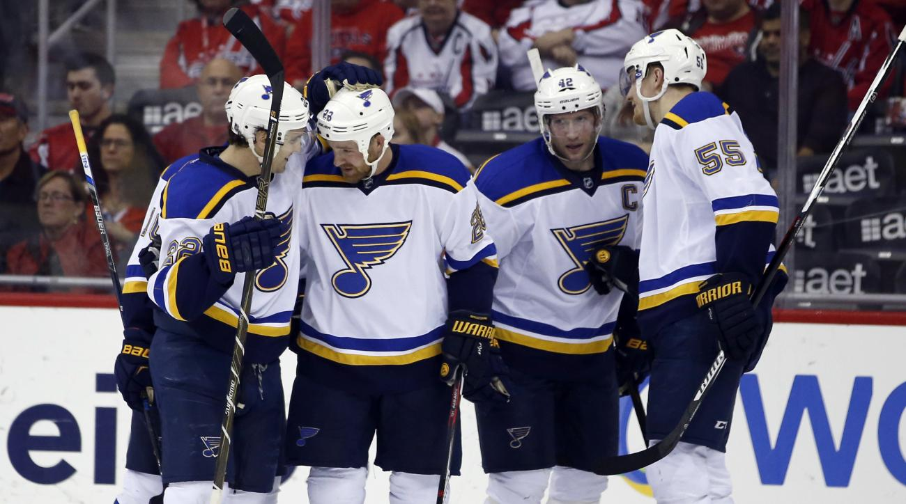 St. Louis Blues defenseman Kevin Shattenkirk (22), center Kyle Brodziak (28), center David Backes (42) and defenseman Colton Parayko (55) celebrate a goal by Brodziak in the second period of an NHL hockey game against the Washington Capitals, Saturday, Ma