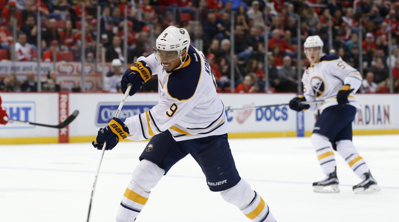 Buffalo Sabres left wing Evander Kane (9) shoots against the Detroit Red Wings in the first period of an NHL hockey game, Monday, March 28, 2016, in Detroit. (AP Photo/Paul Sancya)