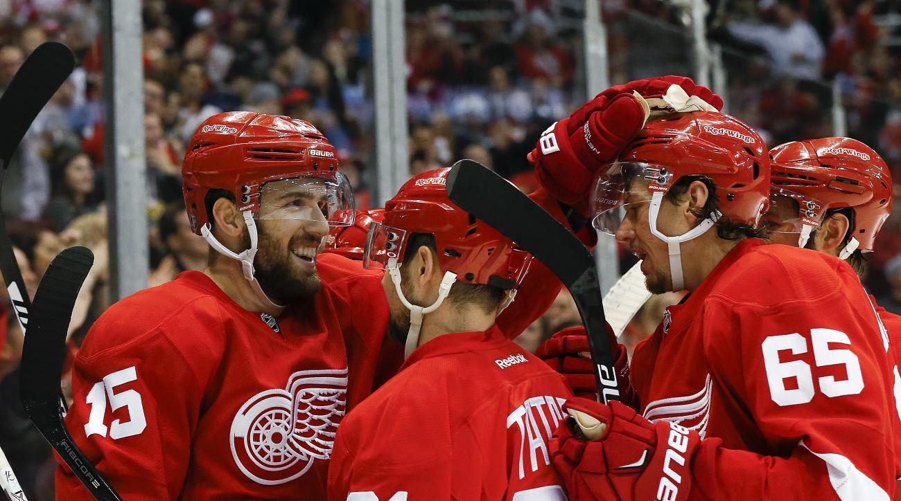 Detroit Red Wings center Riley Sheahan (15) celebrates his goal against the Buffalo Sabres with Tomas Tatar (21) and Danny DeKeyser (65) in the second period of an NHL hockey game, Monday, March 28, 2016, in Detroit. (AP Photo/Paul Sancya)