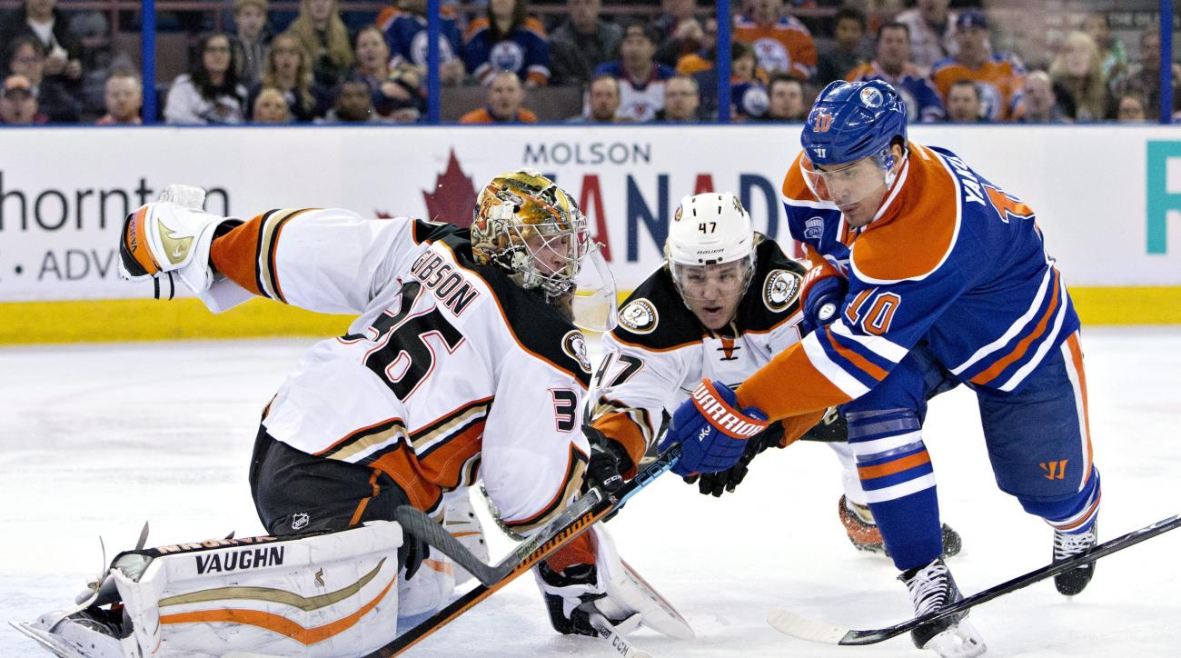 Anaheim Ducks goalie John Gibson (36) makes the save on Edmonton Oilers' Nail Yakupov (10) as Hampus Lindholm (47) defends during first period NHL hockey action in Edmonton, Alberta, Monday, March 28, 2016. (Jason Franson/The Canadian Press via AP)