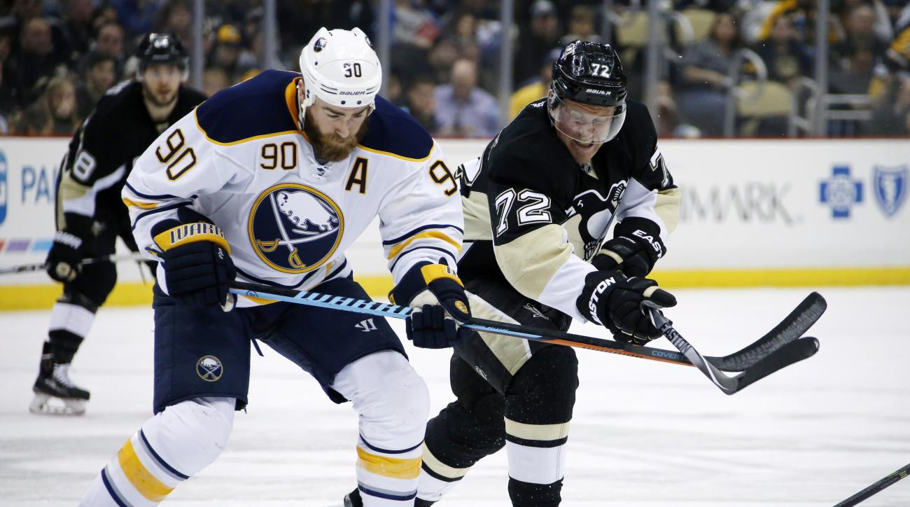 Pittsburgh Penguins' Patric Hornqvist (72) and Buffalo Sabres' Ryan O'Reilly (90) vie for the puck during the second period of an NHL hockey game in Pittsburgh, Tuesday, March 29, 2016. (AP Photo/Gene J. Puskar)