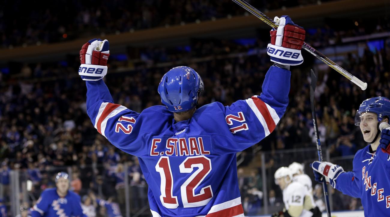 FILE - In this March 27, 2016, file photo, New York Rangers' Eric Staal reacts after scoring his second goal during the second period of an NHL hockey game against the Pittsburgh Penguins, in New York. Eric Staal has made the mundane commute hundreds of t