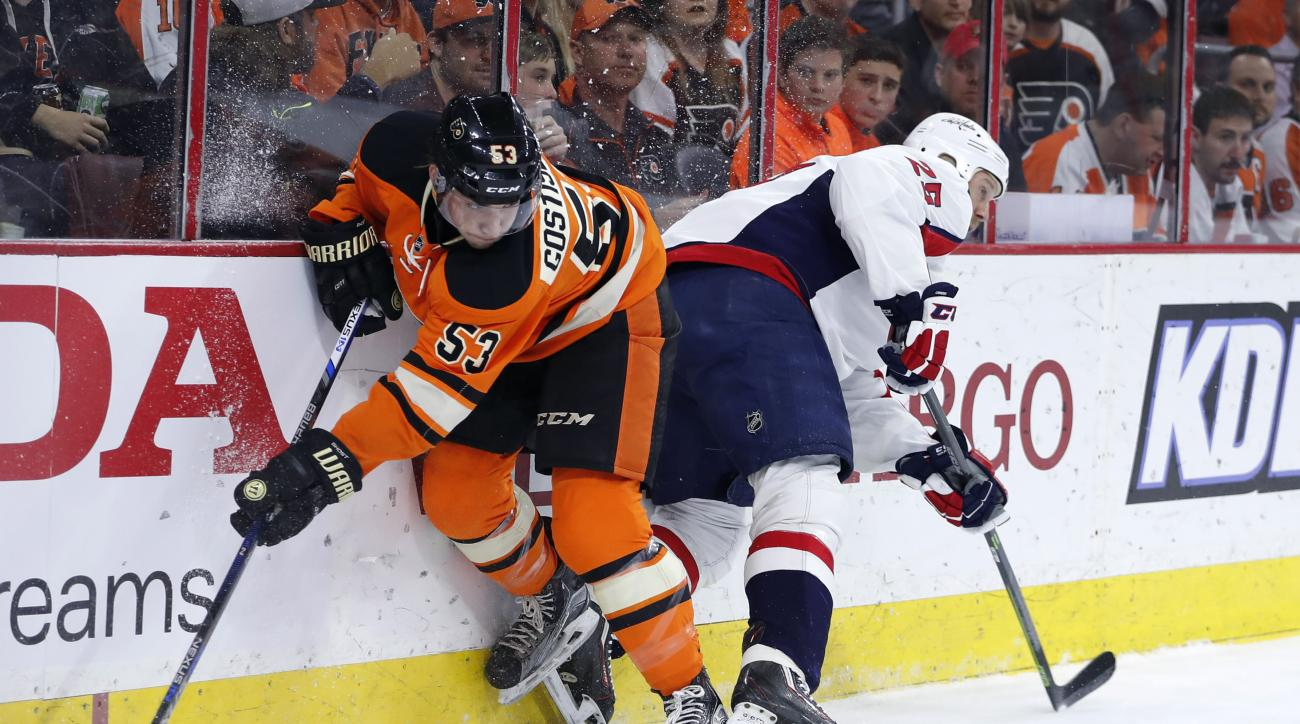Philadelphia Flyers' Shayne Gostisbehere, left, and Washington Capitals' Jason Chimera collide during the first period of an NHL hockey game, Wednesday, March 30, 2016, in Philadelphia. (AP Photo/Matt Slocum)