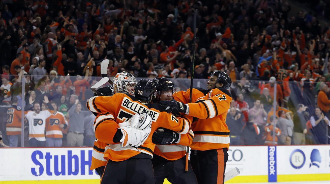 Philadelphia Flyers' Steve Mason, from left, Pierre-Edouard Bellemare, Jakub Voracek and Wayne Simmonds celebrate after winning an NHL hockey game against the Washington Capitals, Wednesday, March 30, 2016, in Philadelphia. Philadelphia won 2-1 in a shoot