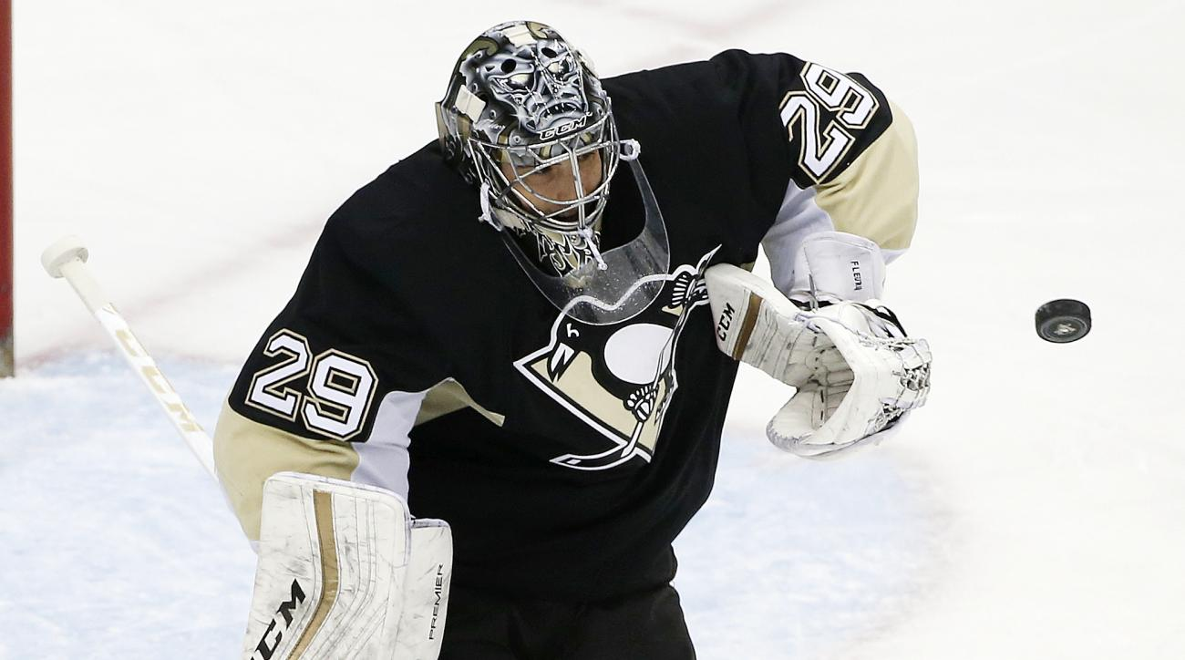 Pittsburgh Penguins goalie Marc-Andre Fleury (29) blocks a shot during the first period of an NHL hockey game against the Nashville Predators in Pittsburgh, Thursday, March 31, 2016. (AP Photo/Gene J. Puskar)
