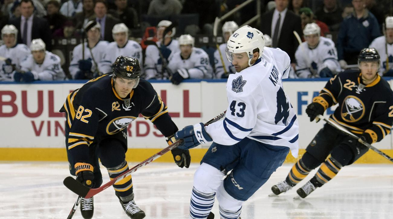 Buffalo Sabres left winger Marcus Foligno (82) vies for the puck as Toronto Maple Leafs center Nazem Kadri (43) spins past during the second period of an NHL hockey game, Thursday, March 31, 2016, in Buffalo, N.Y. (AP Photo/Gary Wiepert)