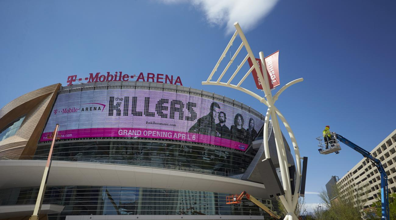 In this Monday, March 28, 2016, photo, workers finish construction on T-Mobile Arena in Las Vegas. MGM officials think they will hit the jackpot with a new $375 million arena that sits in the middle of the glittering Las Vegas Strip. (AP Photo/John Locher