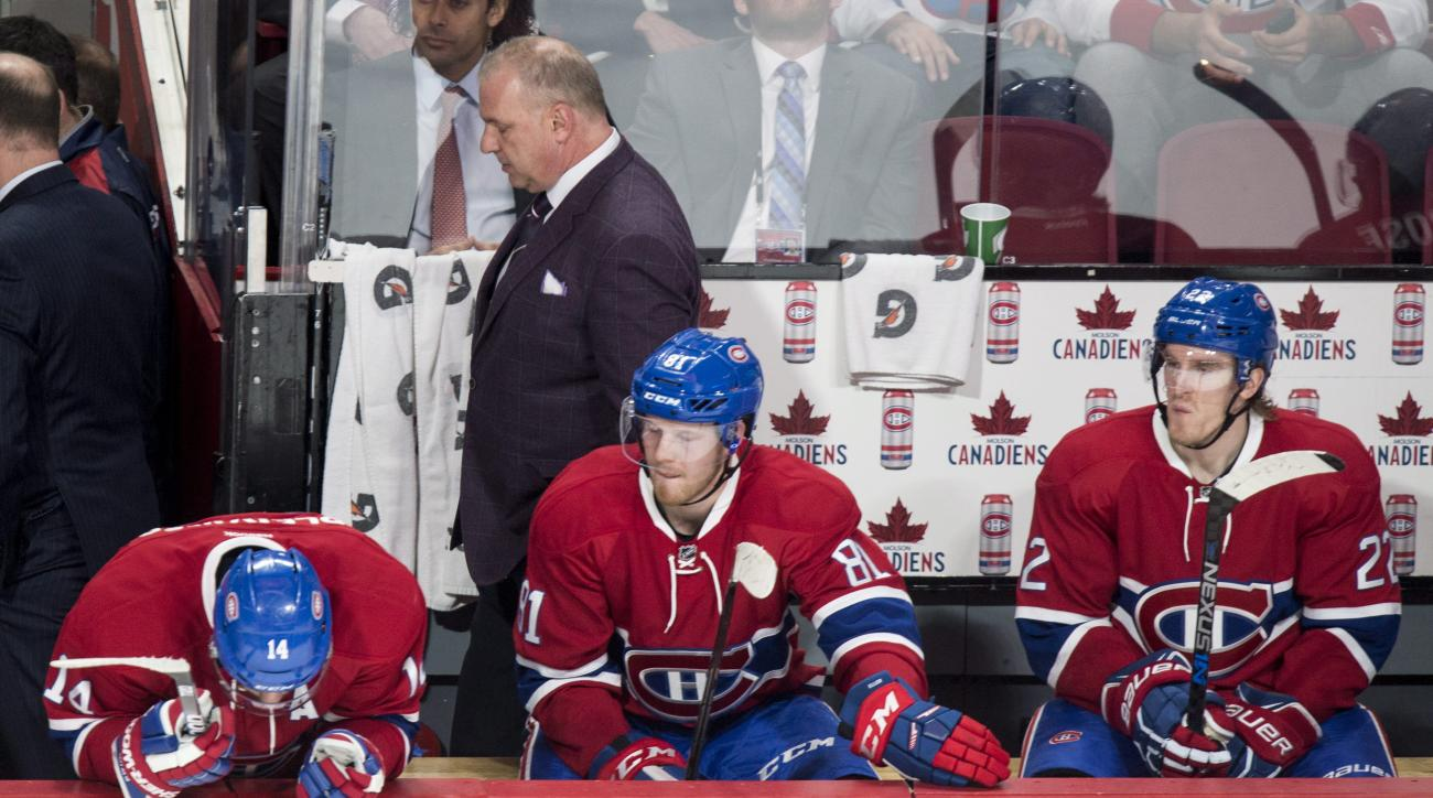 FILE - In this Jan. 26, 2016, file photo, Montreal Canadiens coach Michel Therrien walks out past players, from left, Tomas Plekanec, Lars Eller Dale Weise, after the team's 5-2 loss to the Columbus Blue Jackets in an NHL hockey game in Montreal. For the
