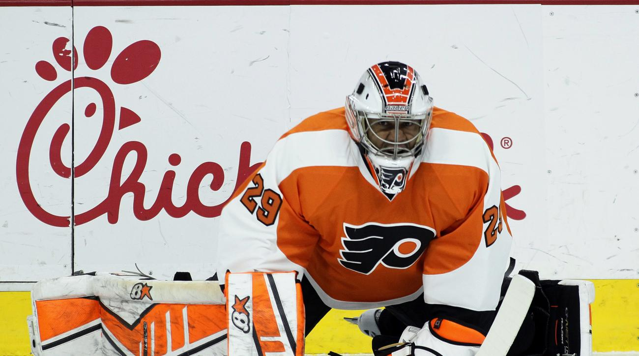 FILE - In this Jan. 27, 2015, file photo, Philadelphia Flyers goalie Ray Emery stretches before an NHL hockey game against the Arizona Coyotes in Philadelphia. The Flyers say Friday, April 1, 2016, that theyre signing Emery to a contract for the remainder