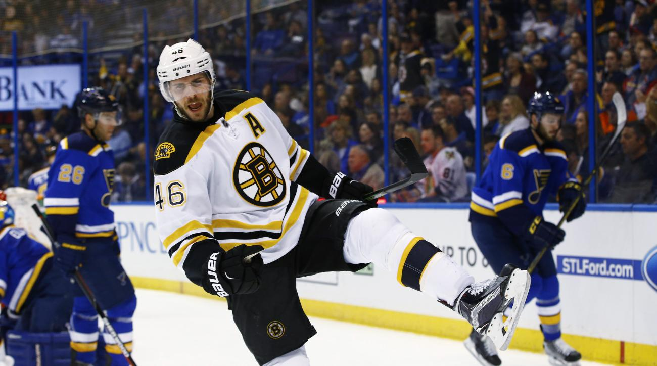 Boston Bruins David Krejci, of the Czech Republic, celebrates after scoring a goal during the first period of an NHL hockey game against the St. Louis Blues, Friday, April 1, 2016, in St. Louis. (AP Photo/Billy Hurst)