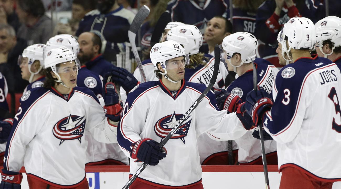 Columbus Blue Jackets' Brandon Saad (20) is congratulated by team mates following Saad's goal against the Carolina Hurricanes during the second period of an NHL hockey game in Raleigh, N.C., Saturday, April 2, 2016. (AP Photo/Gerry Broome)