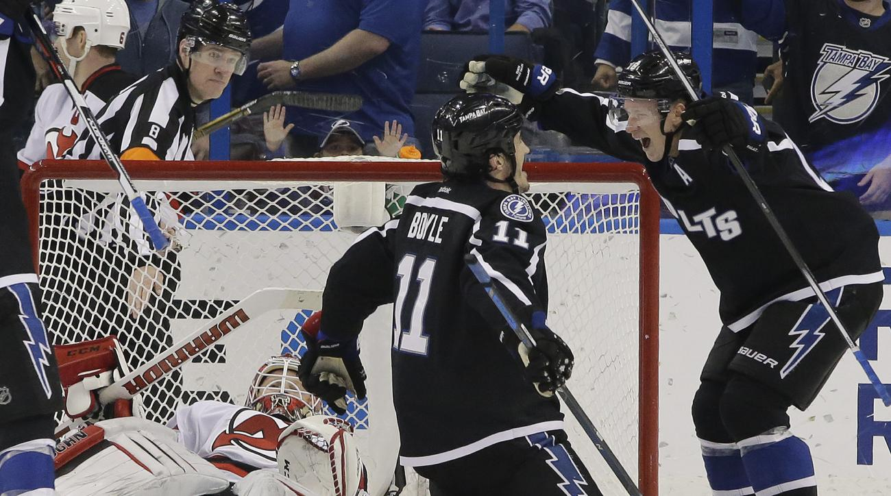 Tampa Bay Lightning center Brian Boyle (11) celebrates his goal against the New Jersey Devils with left wing Ondrej Palat (18), of the Czech Republic, during the third period of an NHL hockey game Saturday, April 2, 2016, in Tampa, Fla. (AP Photo/Chris O'
