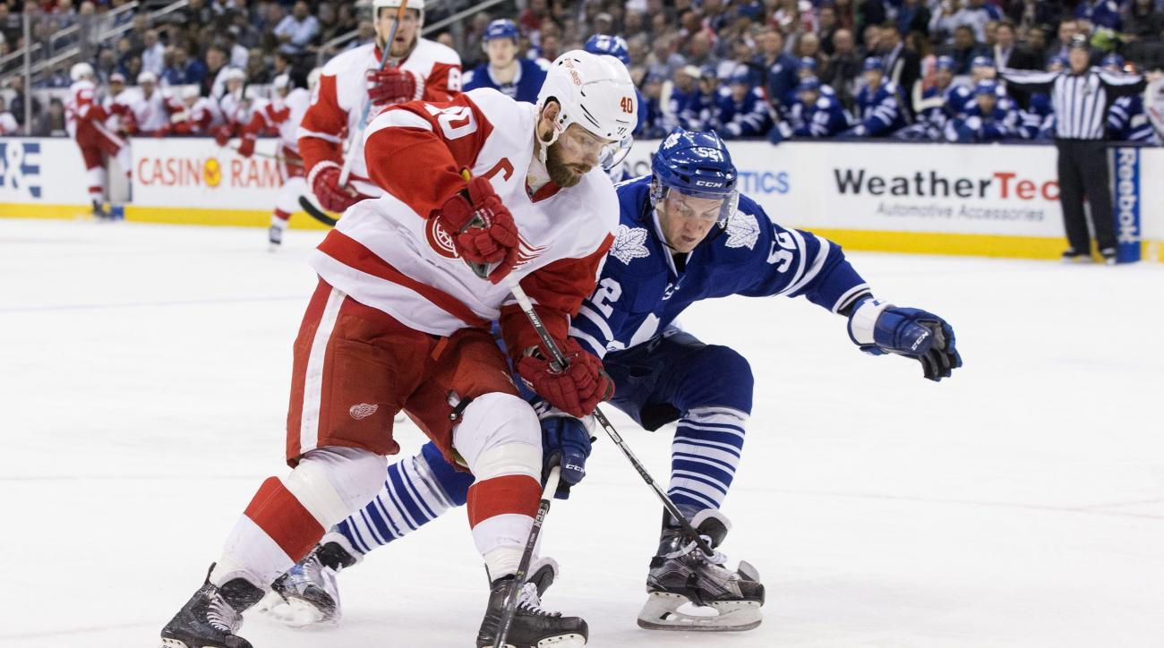 Detroit Red Wings' Henrik Zetterberg (40) carries the puck past Toronto Maple Leafs' Martin Marincin (52) during third period NHL hockey action in Toronto on Saturday April 2, 2016. (Chris Young/The Canadian Press via AP)