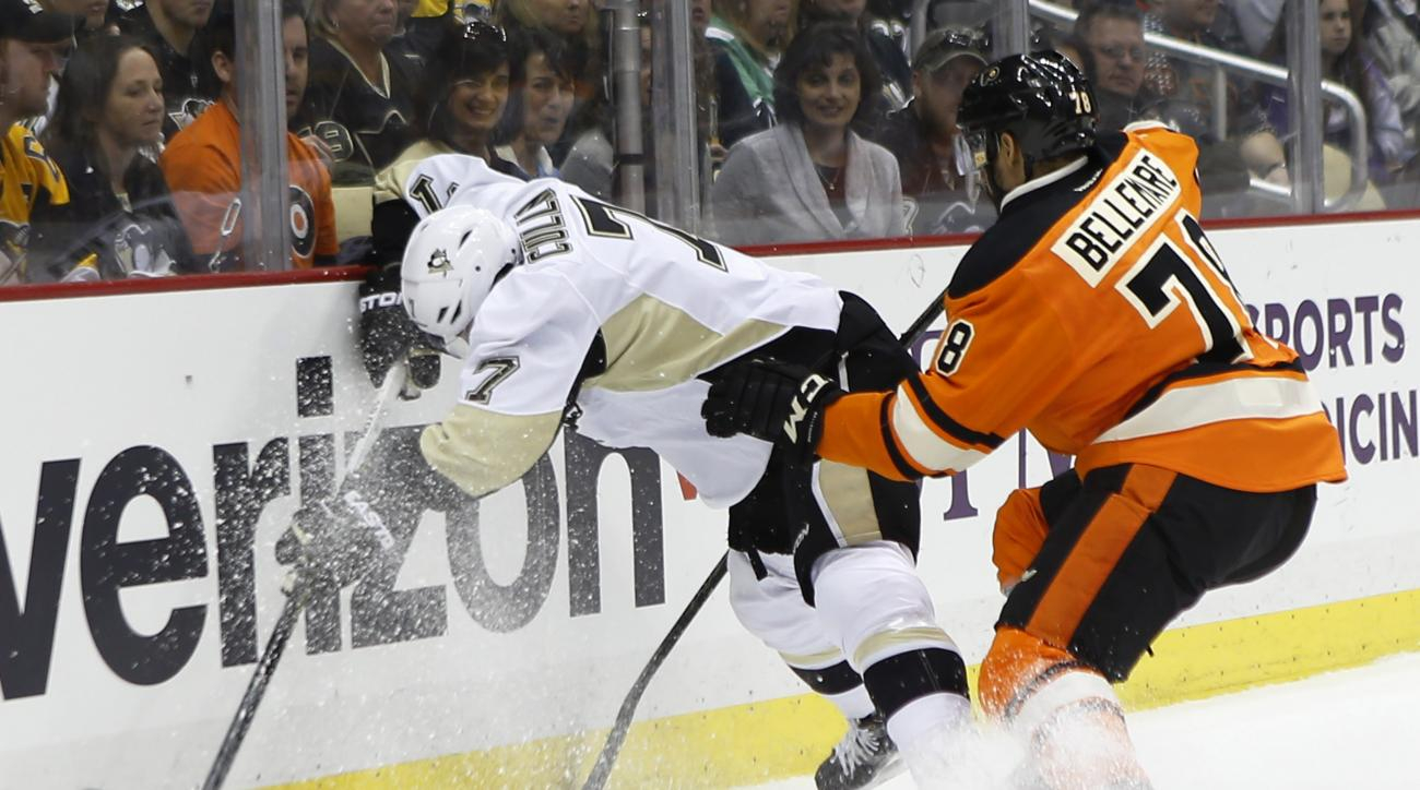 Pittsburgh Penguins' Matt Cullen (7) tries to control the puck along the boards as Philadelphia Flyers' Pierre-Edouard Bellemare (78) checks him in the second period of an NHL hockey game, Sunday, April 3, 2016 in Pittsburgh. (AP Photo/Keith Srakocic)